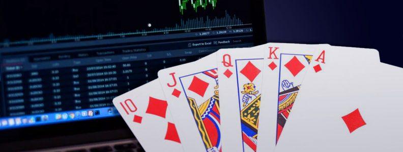 Tangan Poker di Depan Laptop Dengan Informasi Pasar Saham Ditampilkan
